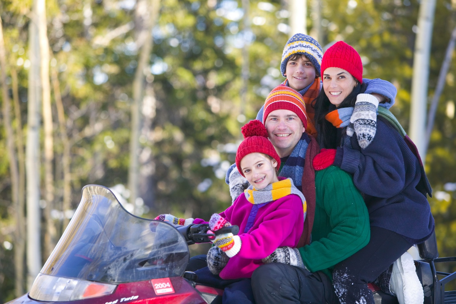 family on snowmobile