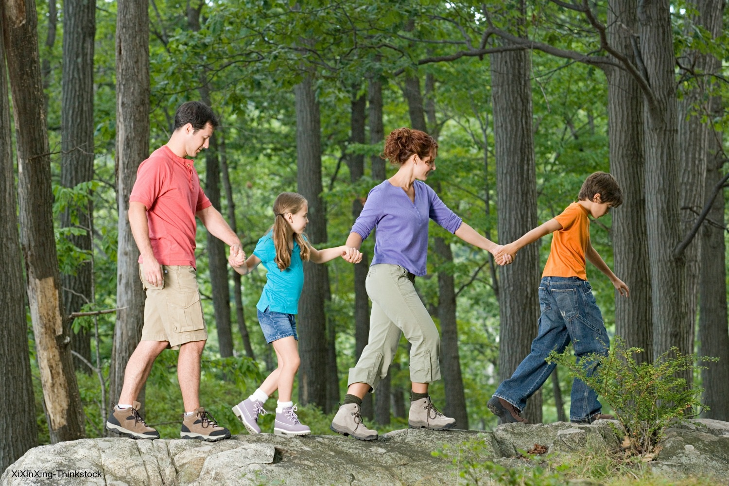 kids and parents walking through the woods