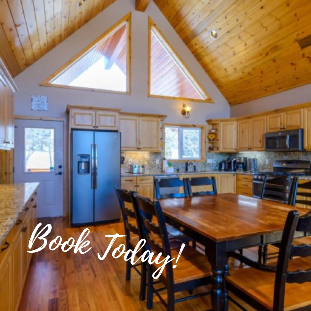"""Arched Oak Acres living area with """"Book Today"""" overlay text"""