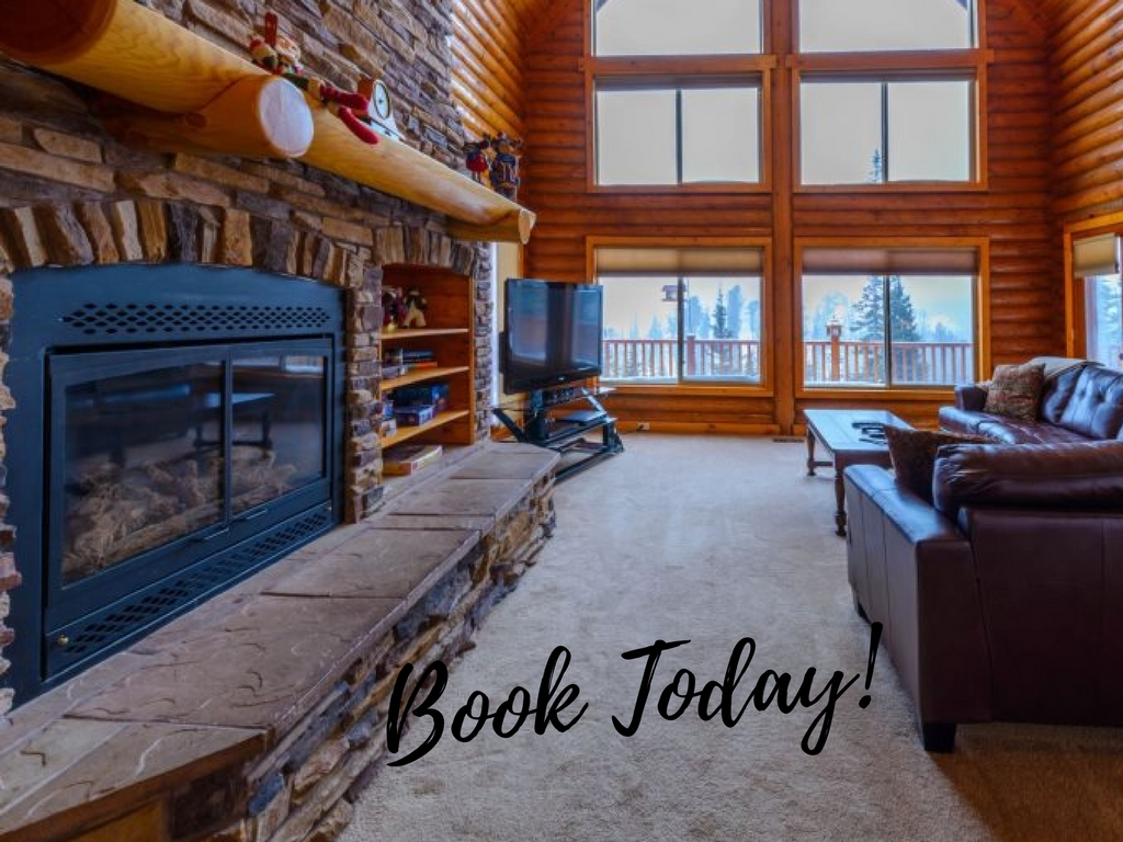 "Overlook Lodge living area with ""Book Today"" overlay text"
