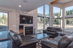 The living room and outside view from the Park-U-Pine Chalet rental