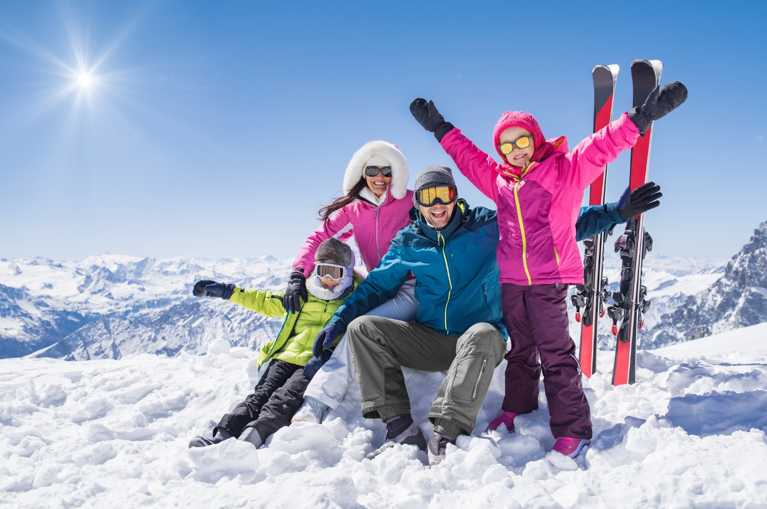 Family skiing in the snow