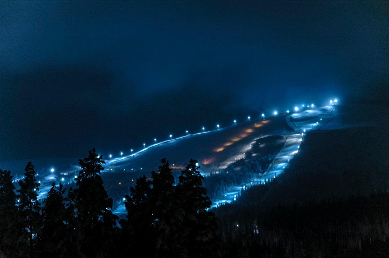 ski slopes at night under the lights