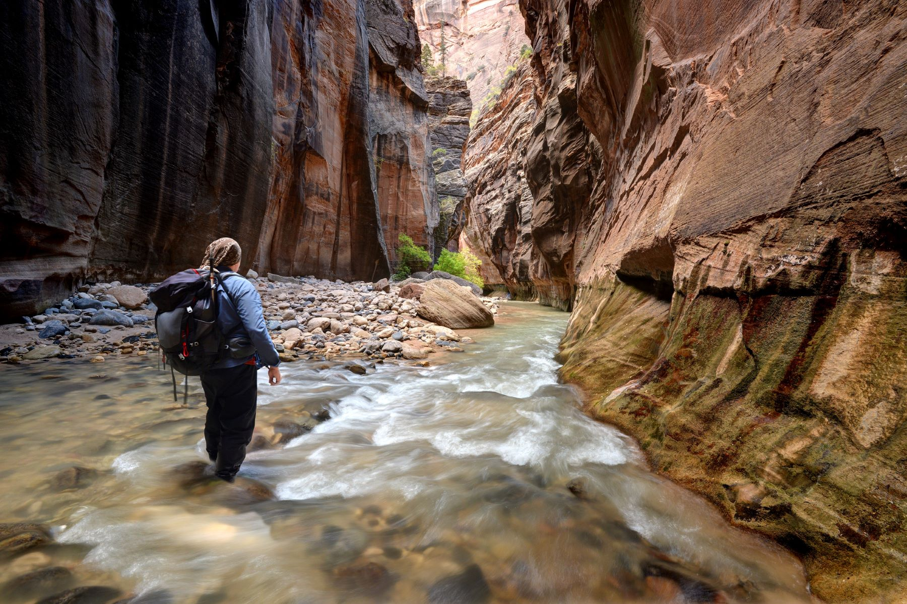 a person walking through The Narrows